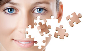 Healh concept image - Beautiful young woman with puzzle pieces