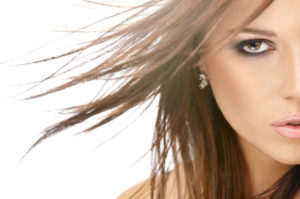 Close up - a half of face of beauty with flying hair, isolated